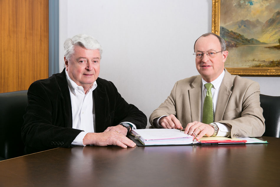 image of Day Rettig Martin, P.C. with a client in his law office